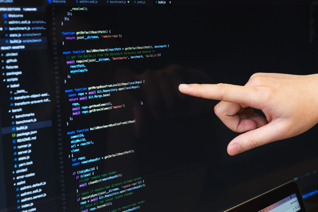 finger-pointing-at-javascript-code